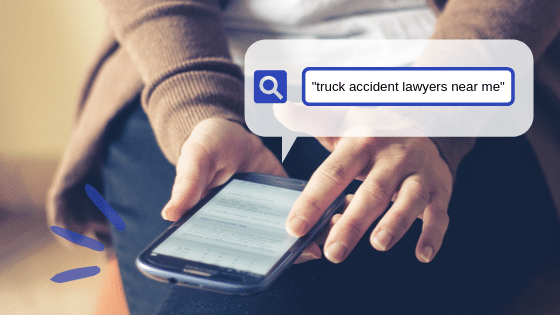 Person searching for truck accident lawyers online.
