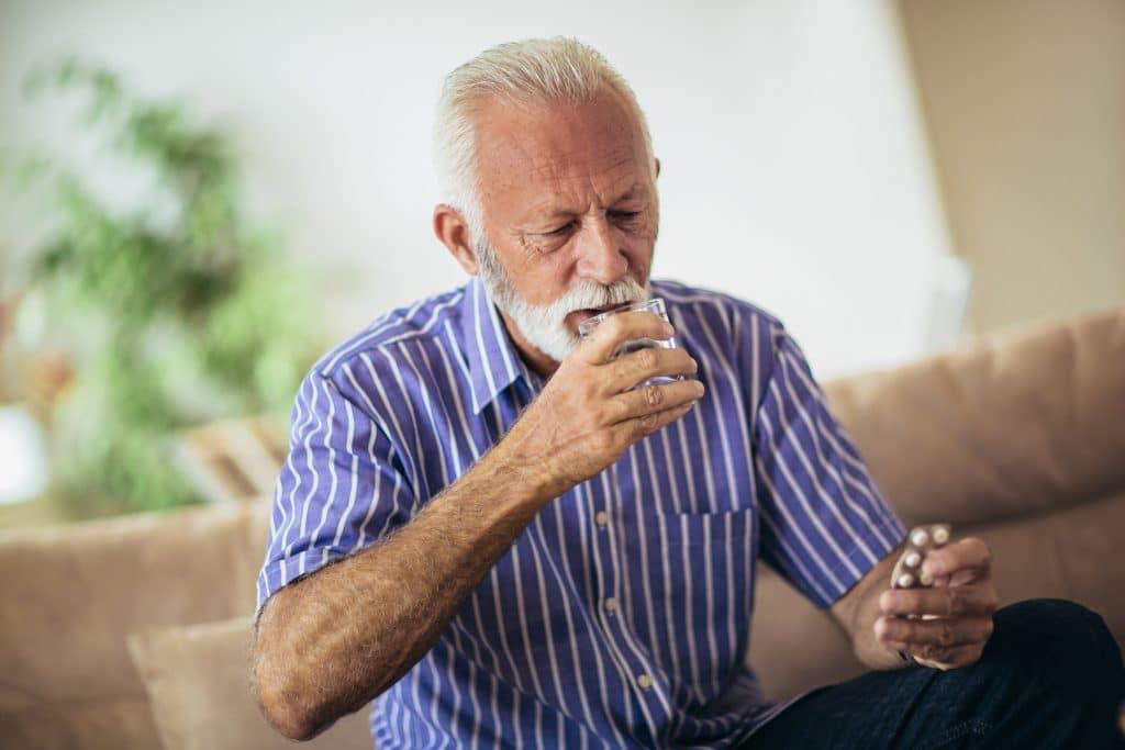 Man Taking Zantac Pill