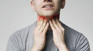 Man Touching His Inflamed Lymphnodes