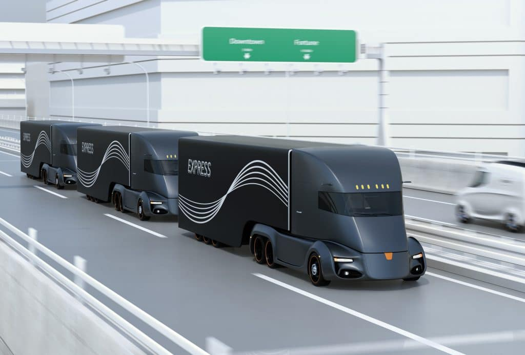 An image of self-driving trucks on the highway